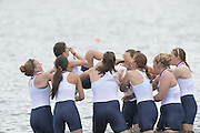 San Diego, California. USA.  University of Washington women, carry the cox to the waters edge before dunking here in the traditional manner.  2013 Crew Classic Regatta, Mission Bay.  11:55:39.  Sunday  07/04/2013   [Mandatory Credit. Peter Spurrier/Intersport Images]  ..