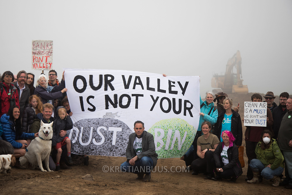 Protect Pont Valley 2018. Locals have fought the open cast coal mine for thirty years and three times the local council rejected planning permissions but central government has overuled that decission. Banks Group bought  the license and rights to extract coal and declared in early 2018 they were to commence extracting coal in accordance with the liicence by June 4th 2018. Locals have teamed up with climate campaigners and together they try to pevent the mining from going ahead. A rare species of crested newt live on the land planned for mining and protectors are trying to stop the mine to save the newt, the valley and their communities from pollution. Commercial coal exploitation and burning of fossil fuels is hugely contributing to climate change and campaigners want to keep the coal in the hole.