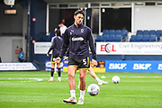 AFC Wimbledon Defender Will Nightingale (5) warms-up ahead of the EFL Sky Bet League 1 match between Luton Town and AFC Wimbledon at Kenilworth Road, Luton, England on 23 April 2019.