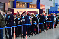 © Licensed to London News Pictures. 03/10/2018. Birmingham, UK. Queues outside the hall ahead of Leaders speech on the fourth and final day of the 2018 Conservative Party conference at the ICC in Birmingham. This years event is focused heavily on Brexit and negotiations with the EU over the UK's exit form the European Union. Photo credit: Ben Cawthra/LNP