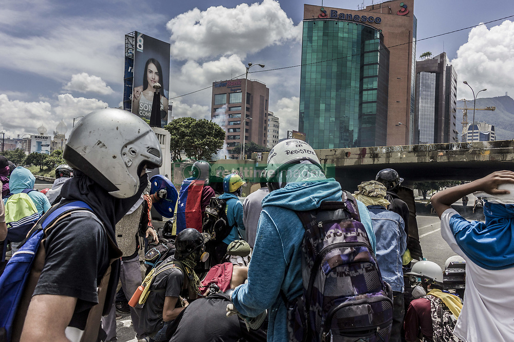 June 19, 2017 - Caracas, Distrito Capital, Venezuela - Caracas, Venezuela, Monday, June 19, 2017. Nearly 70 people have died, hundreds more have been injured and thousands have been detained in months of almost daily protests demanding new elections as the nation battles triple-digit inflation, crippling food and medical shortages and rising crime. (Credit Image: © Marcos Canizares/VW Pics via ZUMA Wire)