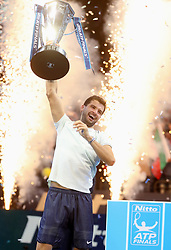 Grigor Dimitrov celebrates winning the Men's Singles Final by holding aloft the trophy, during day eight of the NITTO ATP World Tour Finals at the O2 Arena, London.