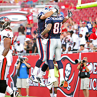 New England wide receiver Aaron Hernandez (81) celebrates his touchdown catch during an NFL football game between the New England Patriots and the Tampa Bay Buccaneers at Raymond James Stadium on Thursday, August 18, 2011 in Tampa, Florida.   (Photo/Alex Menendez)
