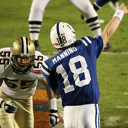 2010 February 07: New Orleans Saints linebacker Scott Fujita (55) hits Indianapolis Colts quarterback Peyton Manning (18) as he throws during a 31-17 win by the New Orleans Saints over the Indianapolis Colts in Super Bowl XLIV at Sun Life Stadium in Miami Gardens, Florida.