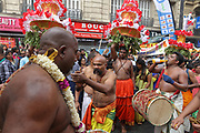 Dancers, drummers and men wearing tall headdresses with paper flowers, in the parade celebrating the festival of Ganesh Chaturthi, marking the birth of the Hindu god Ganesha, on the streets of the La Chapelle area of the 18th arrondissement of Paris, France, on Sunday 1st September 2019. The annual religious festivities and parade take place near the Ganesha Temple of Paris, or Sri Manicka Vinayakar Alayam Temple, the largest Hindu temple in France. Ganesha is the elephant-headed Hindu God of Beginnings, son of Shiva and Parvati, who represents love and knowledge. Picture by Manuel Cohen