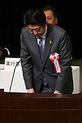 Japan's Prime Minister Shinzo Abe bows in front of the assembly after giving a speech during a Northern Territories Day rally to give clarification about the situation in the Northern Territories in Japan, at the National Theater in Tokyo on February 7, 2018. 07/02/2018-Tokyo, JAPAN