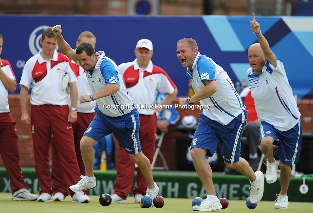Commonwealth Games, Glasgow 2014<br /> Kelvingrove - Lawn Bowls<br /> <br /> Men's Four's Final<br /> Scotland (David Peacock, Neil Speirs, Paul Foster and  Alex Marshall, ) v England (Andrew Knapper, John McGuiness, Stuart Airey and Jamie Chestney<br /> The Scots celebrate after another end winning shot from Alex Marshall<br /> <br />  Neil Hanna Photography<br /> www.neilhannaphotography.co.uk<br /> 07702 246823