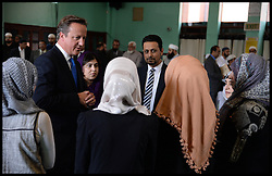 The Prime Minister David Cameron visits the Jamia Mosque in Manchester as part of the Big Iftar.<br /> Wednesday, 7th August 2013<br /> Picture by Andrew Parsons / i-Images