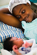 Rebecca Martey lies in bed with her 1-day-old son Gerald at the Osu Maternity Home in Accra, Ghana on Tuesday June 16, 2009.