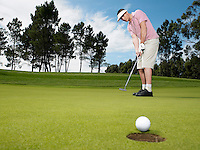 Golfer putting low angle view