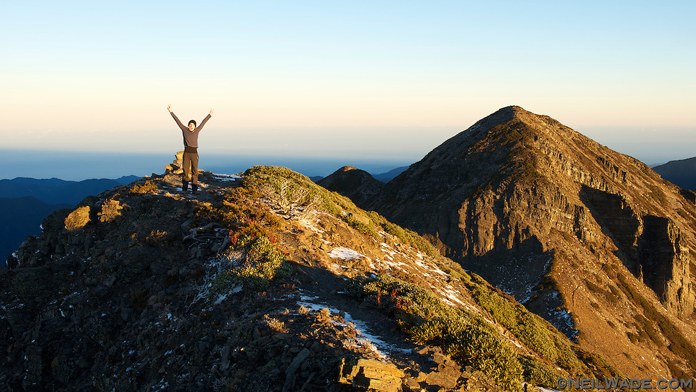 A happy hiker celebrates on the Snow Mountain Peak.