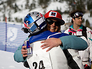 Sherry McConkey congradulates daron rahlves on his Chinese Downhill win.