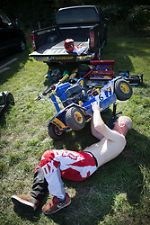 © Licensed to London News Pictures. 24/09/2016. Five Oaks, UK. A competitor prepares his ride-on mower at the Lawn Mower Racing World Championships. A weekend long set of races will see a World Champion announced on Sunday. Photo credit: Peter Macdiarmid/LNP
