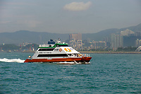 Hydrofoil ferry croosing harbour, Hong Kong, Hong Kong, August 2008   Photo: Peter Llewellyn