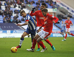 Michael Jacobs of Wigan Athletic (L) in action against Philip Billing (C) and Martin Cranie of Huddersfield Town - Mandatory by-line: Jack Phillips/JMP - 02/01/2017 - FOOTBALL - DW Stadium - Wigan, England - Wigan Athletic v Huddersfield Town - Football League Championship