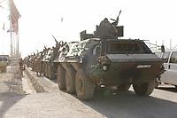 """11 AUG 2003, KABUL/AFGANISTAN:<br /> Transportpanzer """"Fuchs"""", mit Bewaffnung Maschinengewehr, des deutschen Kontingents der International Security Assistance Force, ISAF, in Konvoi Aufstellung vor einer Fahrt nach Kabul, Camp Warehouse,  Lager der ISAF Truppen in der Naehe von Kabul<br /> IMAGE: 20030811-01-093<br /> KEYWORDS: Bundeswehr, Streitkraefte, Streitkräfte,   Panzer, Tank, MG"""