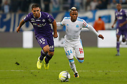 Andy Delort of TFC and Clinton Njie of OM during the French Championship Ligue 1 football match between Olympique de Marseille and Toulouse FC on September 24, 2017 at Orange Velodrome stadium in Marseille, France - Photo Philippe Laurenson / ProSportsImages / DPPI