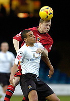 Photo: Leigh Quinnell.<br /> Luton Town v Cardiff City. Coca Cola Championship. 01/01/2007. Cardiffs Willo Flood rises above Lutons Dean Morgan.