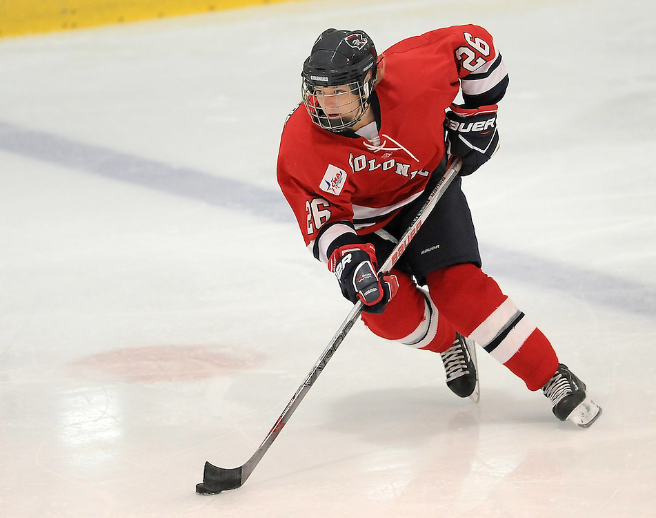 PITTSBURGH, PA - OCTOBER 14:  Mackenzie Johnston #26 of the Robert Morris Colonials skates with the puck in the first period during the game against the Vermont Catamounts at 84 Lumber Arena on October 14, 2016 in Pittsburgh, Pennsylvania. (Photo by Justin Berl)