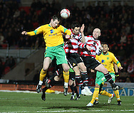 Doncaster - Friday January 30th 2009:Jonathan Grounds of Norwich City & Brian Stock of Doncaster Rovers in action during the Coca Cola Championship Match at The Keepmoat Stadium Doncaster. (Pic by Steven Price/Focus Images)