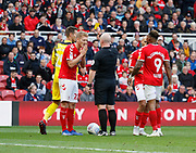 Referee Simon Hooper shows a yellow card for diving to Middlesbrough midfielder George Saville (22)  during the EFL Sky Bet Championship match between Middlesbrough and Swansea City at the Riverside Stadium, Middlesbrough, England on 22 September 2018.