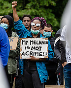 Lady protester with fist in the air during black lives matter protest during the Black Lives Matter protest in Cardiff, Wales on 6 June 2020.