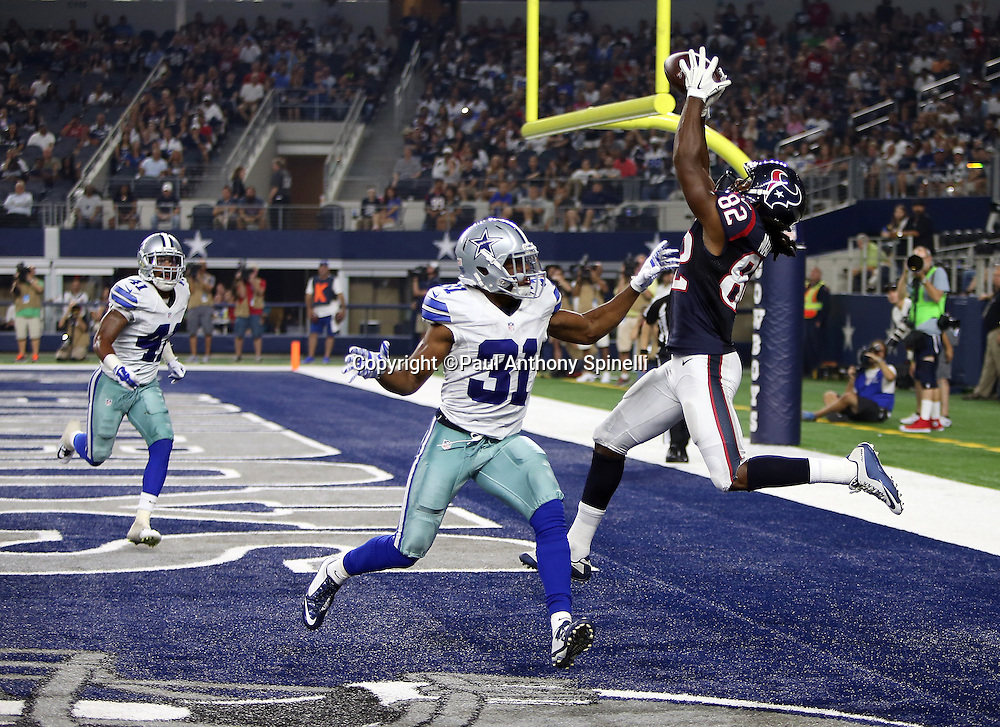 Houston Texans wide receiver Keshawn Martin (82) makes a leaping catch for a fourth quarter touchdown that ties the score at 14-14 while covered by Dallas Cowboys rookie cornerback Byron Jones (31) during the 2015 NFL preseason football game against the Dallas Cowboys on Thursday, Sept. 3, 2015 in Arlington, Texas. The Cowboys won the game 21-14. (©Paul Anthony Spinelli)