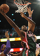Feb. 2, 2011; Phoenix, AZ, USA; Milwaukee Bucks forward Luc Mbah a Moute (12) puts up a shot against the Phoenix Suns at the US Airways Center.  The Suns defeated the Bucks 92-77. Mandatory Credit: Jennifer Stewart-US PRESSWIRE