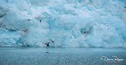 Paddle boarding in front of glacier