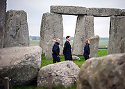 © Licensed to London News Pictures. 01/12/2014. Wiltshire, UK  Nick Clegg accompanied by Dame Helen Ghosh, Director-General of the National Trust and  Alistair Sommerlad, Chair of the new Stonehenge and Avebury WHS Partnership Panel. British Prime Minister Nick Clegg visits The World Heritage Site of Stonehenge in Wiltshire today 1st December 2014. A tunnel passing Stonehenge is among dozens of new road schemes announced by the government, as part of £15bn of improvements to England's roads.. Photo credit : Stephen Simpson/LNP