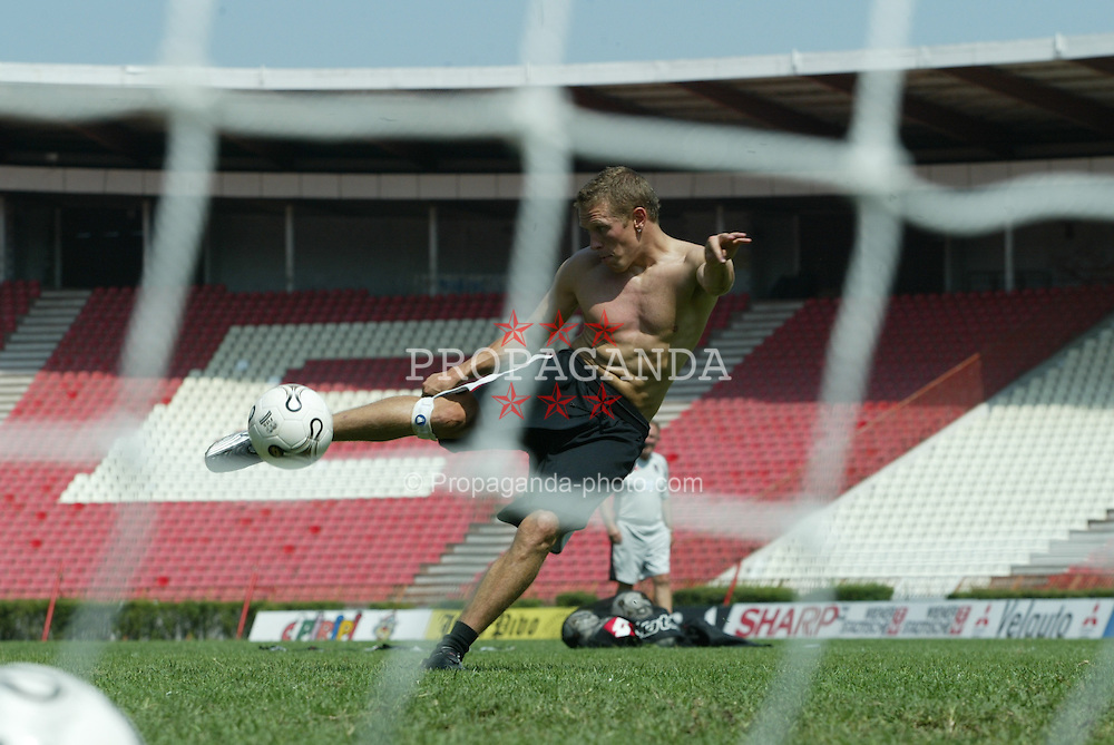 BELGRADE, SERBIA & MONTENEGRO - Tuesday, August 19, 2003: Wales' Craig Bellamy practices his shooting during training at the Red Star Stadium ahead of his side's UEFA European Championship Group 9 qualifying match against Serbia & Montenegro. (Photo by David Rawcliffe/Propaganda)
