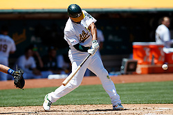 OAKLAND, CA - JULY 28:  Marcus Semien #10 of the Oakland Athletics hits a home run against the Texas Rangers during the third inning at the RingCentral Coliseum on July 28, 2019 in Oakland, California. (Photo by Jason O. Watson/Getty Images) *** Local Caption *** Marcus Semien