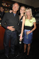 Left to right, CHARLES DELEVIGNE, POPPY DELEVIGNE and PANDORA DELEVIGNE at a leaving party for Poppy Delevigne who is going to New York to persue a career as an actress, held at Chloe, Cromwell Road, London on 25th January 2007.<br /><br />NON EXCLUSIVE - WORLD RIGHTS
