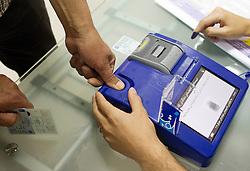 © Licensed to London News Pictures. 30/04/2014. Sulaimaniya, Iraq. A machine is used to check the finger print of an Iraqi Kurdish male against that held on his identity card before he can vote in the 2014 Iraqi parliamentary elections in Sulaimaniya, Iraqi-Kurdistan today (30/04/2014).<br /> <br /> The period leading up to the elections, the fourth held since the 2003 coalition forces invasion, has already seen polling stations in central Iraq hit by suicide bombers causing at least 27 deaths. Photo credit: Matt Cetti-Roberts/LNP