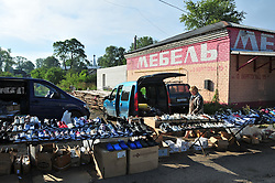 "A local market in Uglich, Russia with a wide selection of shoes. As one of Russia's ""Golden Ring"" cities, Uglich is designated a town of significant cultural and historic importance."