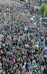 Hibernian Scottish Cup Open Top Bus Edinburgh 14 May 2016; Hibs fans walking behind the team bus during the open top bus parade in Edinburgh after winning the Scottish Cup.<br /> <br /> (c) Chris McCluskie | Edinburgh Elite media