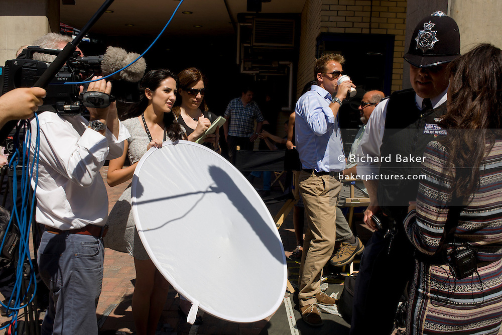 London 19th July 2013: Media interview Met policeman as tension mounts outside St Mary's Hospital, Paddington London, where media and royalists await news of Kate, Duchess of Cambridge's impending labour and birth. Some have been camping out for up to two weeks during a UK heatwave, having bagged the best locations where an heir to the British throne will eventually be shown to the world. Copyright Richard Baker/Alamy Live News