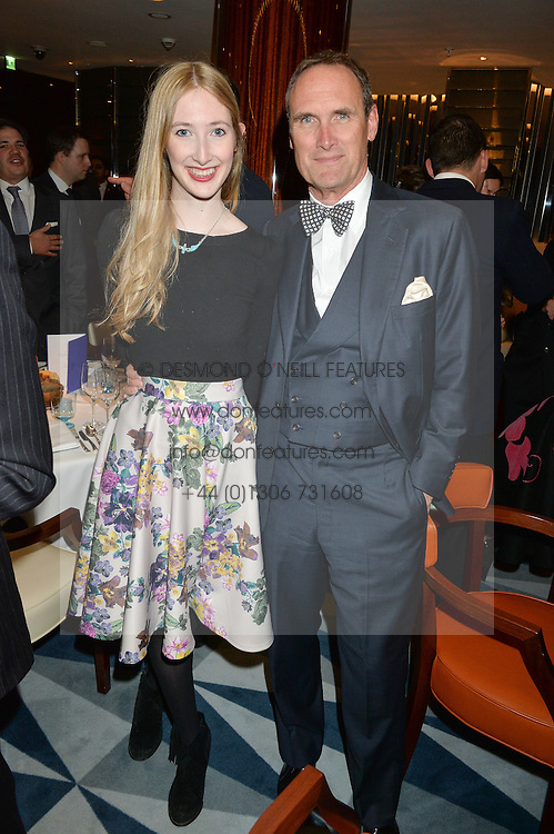 FLORA GILL and her father AA GILLat a dinner hosted by AA Gill & Nicola Formby in support of the Borne charity held at Rivea at the Bulgari Hotel, Knightsbridge, London on 3rd February 2015.