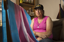 July 27, 2017 - Marietta, GA - MONICA HELMS, 66, served eight years in the U.S. Navy on submarines in the 1970s before coming to terms with her true gender identity and transitioning from lake to female. She created a pink blue and white flag to represent the transgender community in 1999 and the flag is now internationally recognized. She is an outspoken acticitst for transgender rights..PICTURED: Monica in her townhouse north of Atlanta with a transgender flag (Credit Image: © Robin Rayne Nelson via ZUMA Wire)