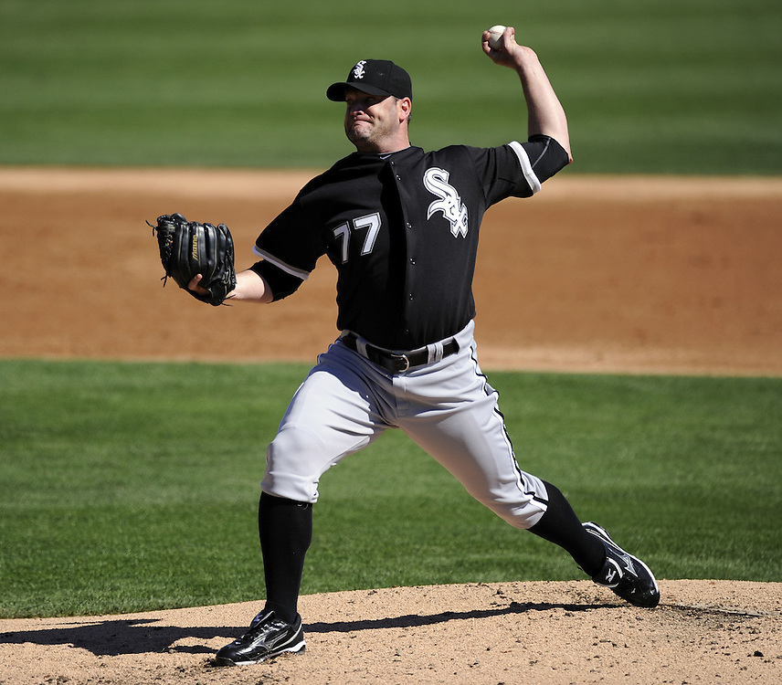 GLENDALE, AZ - FEBRUARY 28:  Will Ohman #77 of the Chicago White Sox pitches against the Los Angeles Dodgers on February 28, 2011 at The Ballpark at Camelback Ranch in Glendale, Arizona. The Dodgers defeated the White Sox 6-5.  (Photo by Ron Vesely)