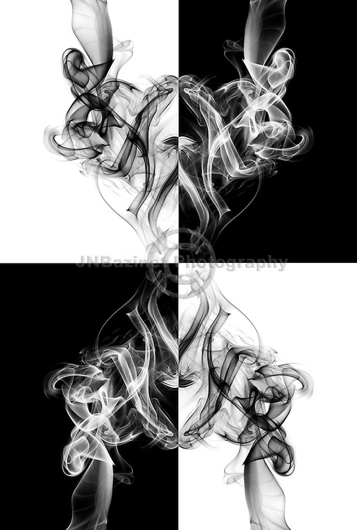 Mirror images of swirling abstract shapes against checkered background