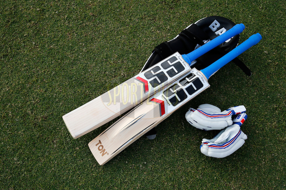 Bat and Gloves during day 1 of the third test match between India and England held at the Punjab Cricket Association IS Bindra Stadium, Mohali on the 26th November 2016.<br /> <br /> Photo by: Deepak Malik/ BCCI/ SPORTZPICS