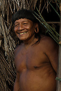 Huaorani Indian - Menga Darita. Gabaro Community. Yasuni National Park.<br /> Amazon rainforest, ECUADOR.  South America<br /> This Indian tribe were basically uncontacted until 1956 when missionaries from the Summer Institute of Linguistics made contact with them. However there are still some groups from the tribe that remain uncontacted.  They are known as the Tagaeri & Taromanani. Traditionally these Indians were very hostile and killed many people who tried to enter into their territory. Their territory is in the Yasuni National Park which is now also being exploited for oil.