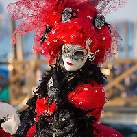 VENICE, ITALY - FEBRUARY 25:  A woman dressed in Carnival Costumes poses in Saint Mark's Square on February 25, 2014 in Venice, Italy. The 2014 Carnival of Venice will run from February 15 to March 4 and includes a program of gala dinners, parades, dances, masked balls and music events.  (Photo by Marco Secchi/Getty Images)