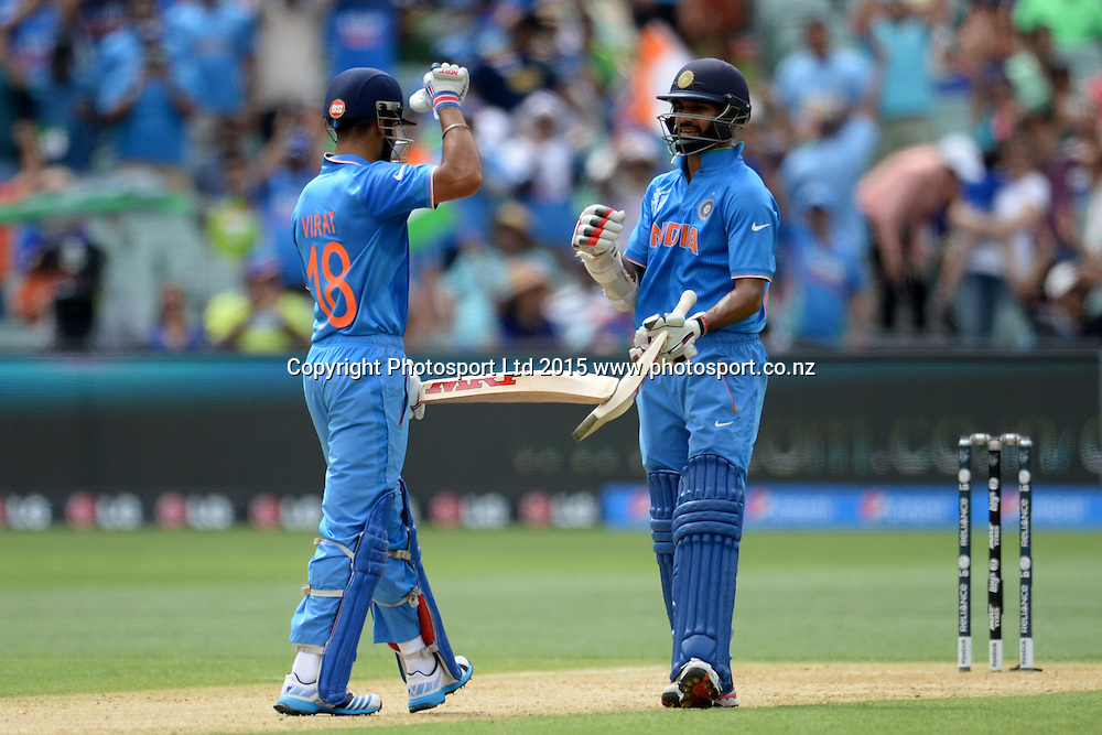 Indian pair Shikhar Dhawan and Virat Kohli celebrate a milestone during the ICC Cricket World Cup match between India and Pakistan at Adelaide Oval in Adelaide, Australia. Sunday 15 February 2015. Copyright Photo: Raghavan Venugopal / www.photosport.co.nz