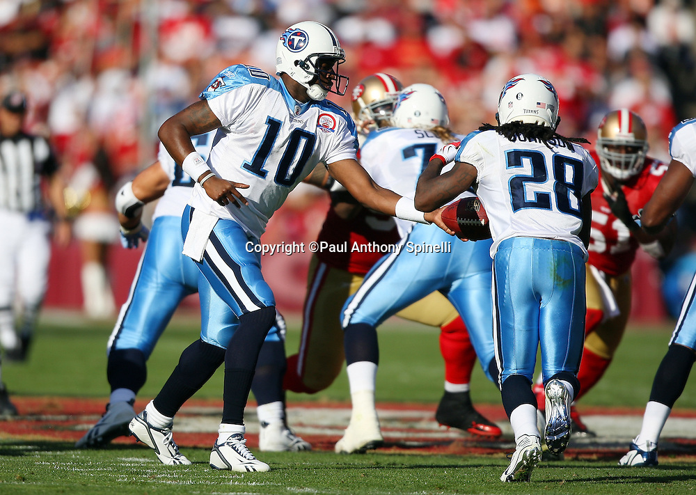 Tennessee Titans quarterback Vince Young (10) hands off the ball to running back Chris Johnson (28) during the NFL football game against the San Francisco 49ers, November 8, 2009 in San Francisco, California. The Titans won the game 34-27. (©Paul Anthony Spinelli)