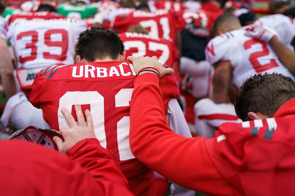 Nebraska players kneel in prayer following Nebraska's annual Spring Game at Memorial Stadium in Lincoln, Neb., on April 21, 2018. © Aaron Babcock