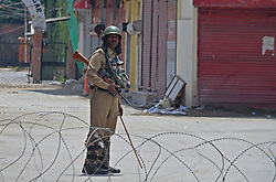 August 15, 2017 - India - An Indian paramilitary soldier guards the check post during restrictions on the eve of official celebrations for India's Independence Day at Bakshi Stadium in Srinagar, the summer capital of Indian administered Kashmir on 15 August 2017. A complete shutdown called by Kashmiri separatists leader and an appeal of black day is being observed across Kashmir on August 15, 2017. (Credit Image: © Faisal Khan/Pacific Press via ZUMA Wire)