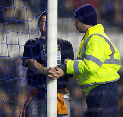 LIVERPOOL, ENGLAND - Tuesday, January 31, 2012: John Foley, protesting about RyanAir's recruitment policy, handcuffs himself to the goalpost of Manchester City's goalkeeper Joe Hart during the Premiership match between Everton and Manchester City at Goodison Park. (Pic by Vegard Grott/Propaganda)