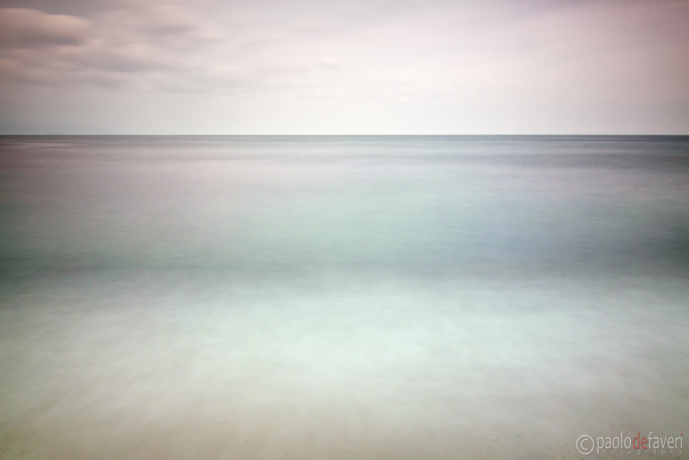 A very long exposure (70 seconds) may turn a very ordinary scene into a surreal, dreamy representation of it. Taken around sunset at a small beach along the Ligurian coast, Italy.